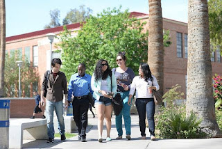 image of a group of students wallking along college campus.