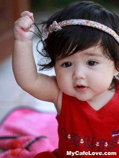 cute baby girl iving pose for her facebook display pic.