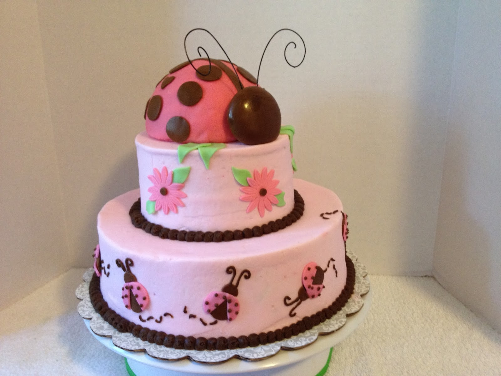 pink brown lady bug baby shower cake