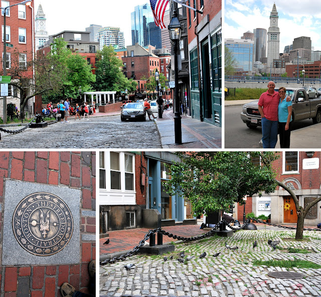 Four pictures of the North End of Boston. Looking south towards the rest of Boston from the square outside Paul Revere's home. Mom and Dad with a portion of the Boston skyline behind them. A seal marking Boston's Freedom Trail outside the Paul Revere house. Pigeons under a tree growing in the square outside the Paul Revere house.
