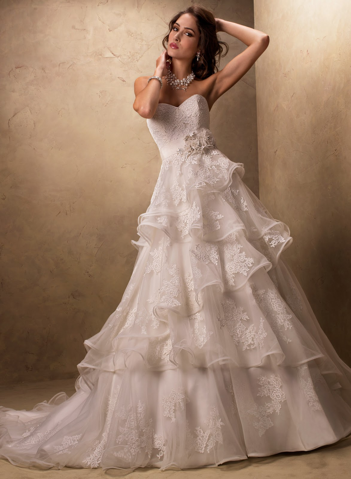 Luxury Tiered Lace Appliqued Wedding Dress With Crystals And Flowers.