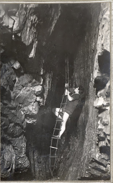 Descent of Long Churn chimney. Long Churn Cave. H.W. Haywood Collection