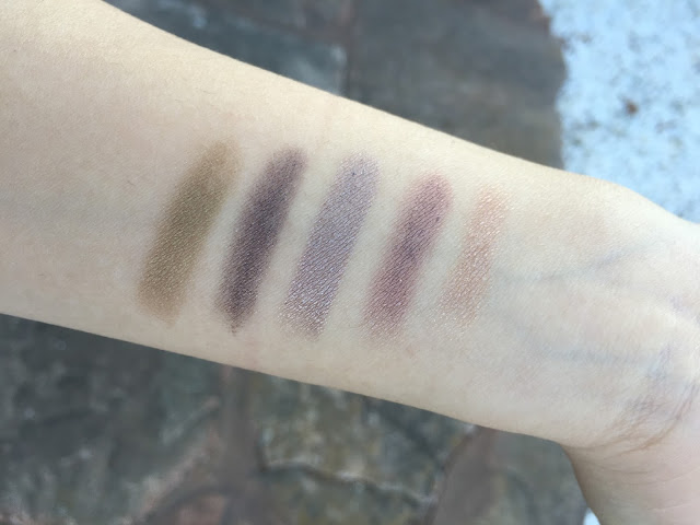 Photo of 100% Pure Eye Creamstick swatches.