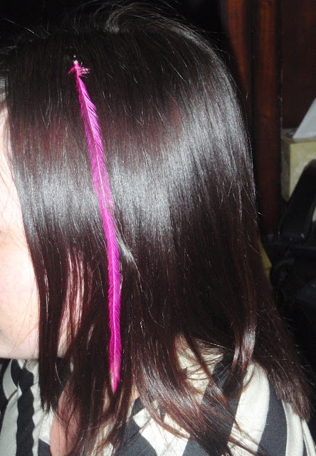hair with pink feather extension