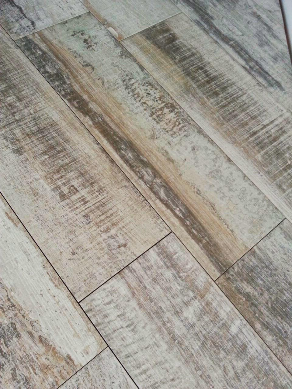 Gtp tarragona reforma la terraza - Ceramica imitacion madera exterior ...