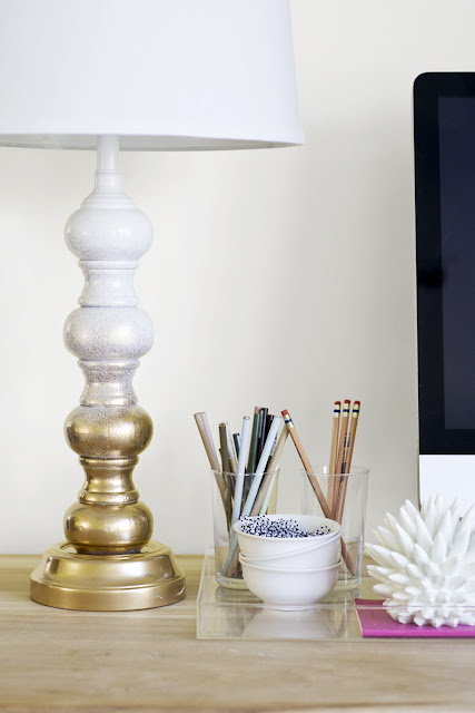 white and gold painted lamp