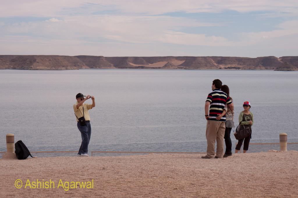 Tourists outside the Abu Simbel temple in south Egypt, at the shore of Lake Nasser