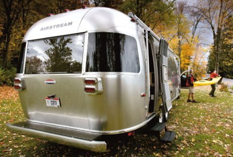 exterior of airstreams land yacht luxury trailer and vanity caravan parked near lake
