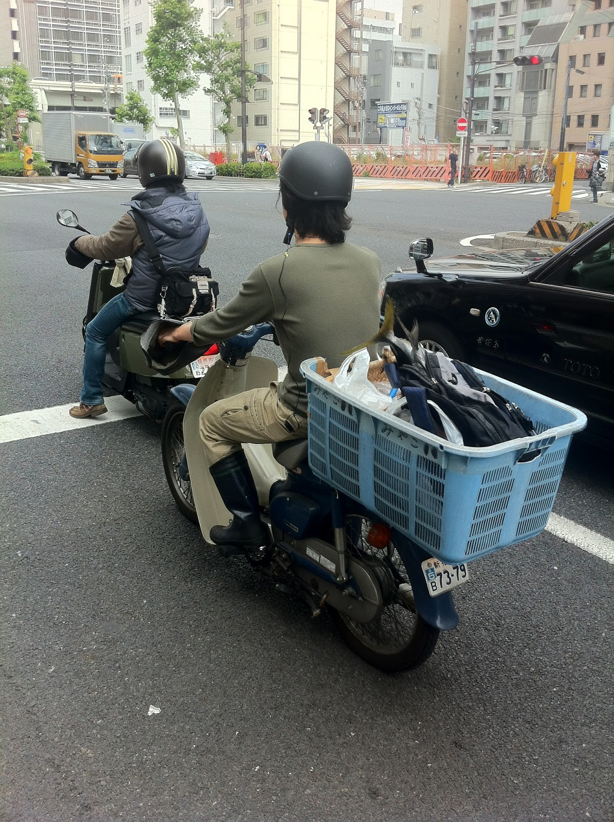 A motorscooter transporting fish on the streets of Tokyo.