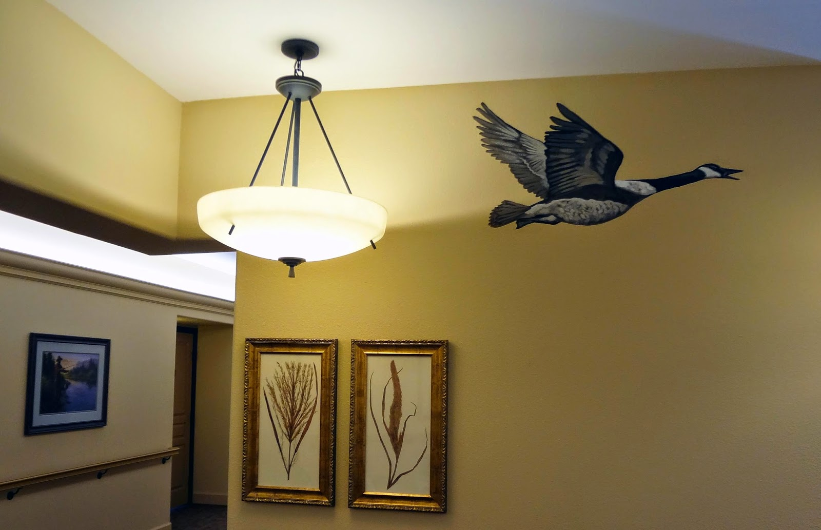 portland oregon muralist, memory care mural, animals painted in hallways