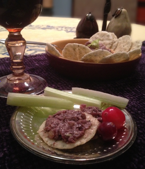Mushroom and Hazelnut Pâté on a plate served with wine and celery