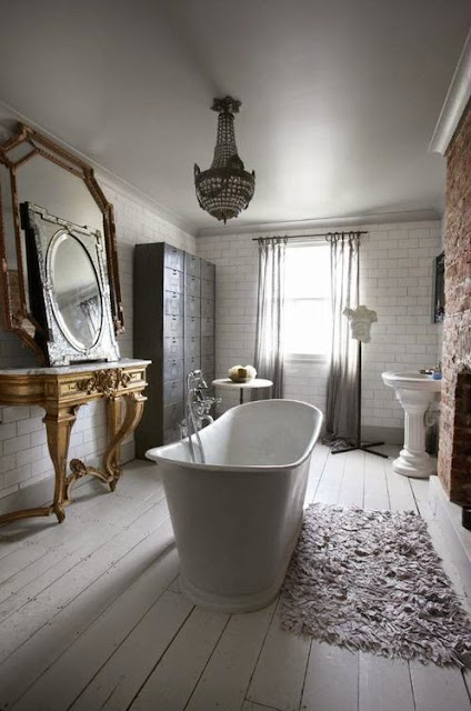rustic original floors master bathroom with stand alone modern tub