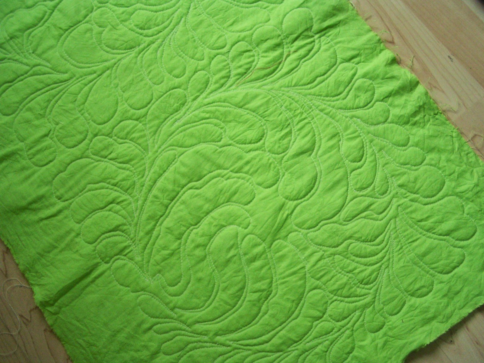 quilting a allover wreath of feathers