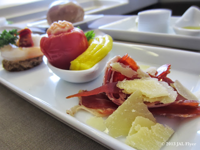 JAL First Class trip report on JL005: Amuse bouche - Iberico ham with parmesan cheese