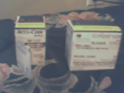picture with a small, cubic, box of test strips, next to a box with twice the volume