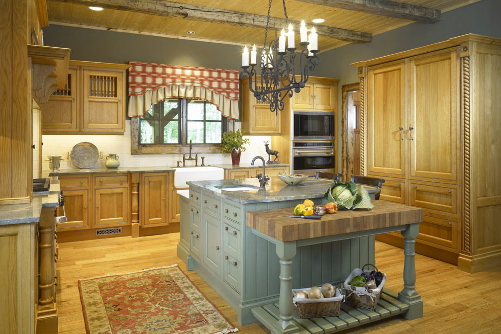 designed this pine kitchen with a contrasting pale blue island