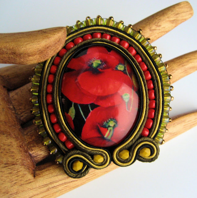 Brooch by Sherri Stokey of Knot Just Macrame using soutache and bead embroidery.