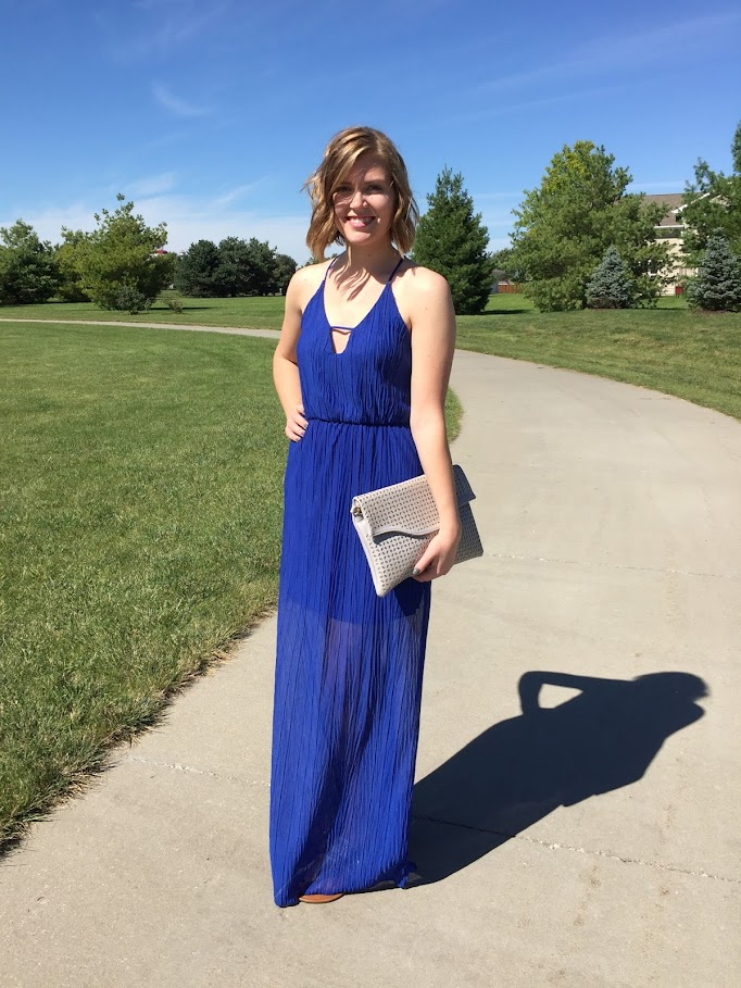 A cobalt blue maxi dress with cutouts for a subtly sexy evening look.