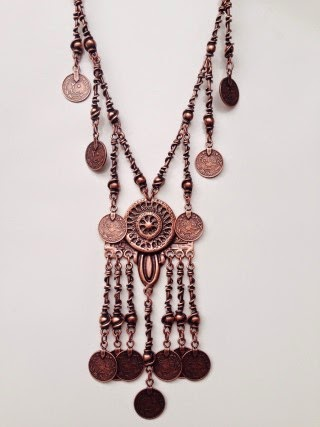 http://www.swankboutiqueonline.com/copper-coin-statement-necklace/