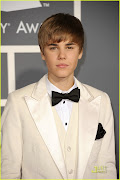 Justin Bieber arrives at the 53rd annual Grammy Awards at the Staples Center . (justin bieber grammy awards )