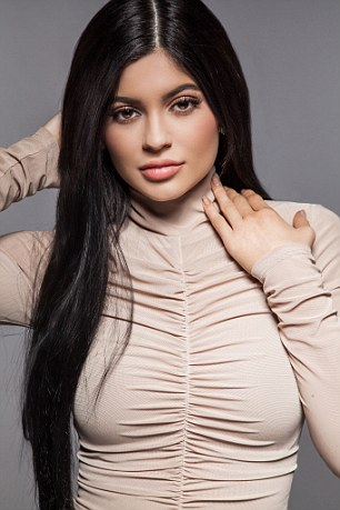 Kylie Jenner looks sensational as she reveals her black bra in a sheer top to celebrate her latest beauty campaign 3