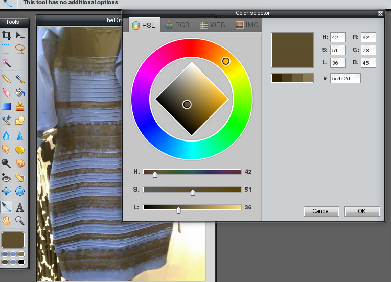 Photo editor showing orange/gold on the colour wheel but very dark on the light / dark scale