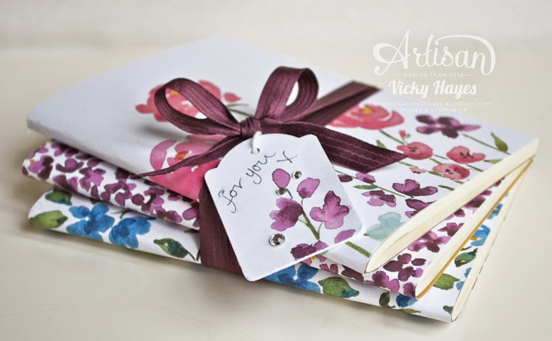 Notebooks covered in the new Painted Blooms designer paper from Stampin' Up