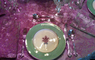 Pink table clots with green and white china dishes