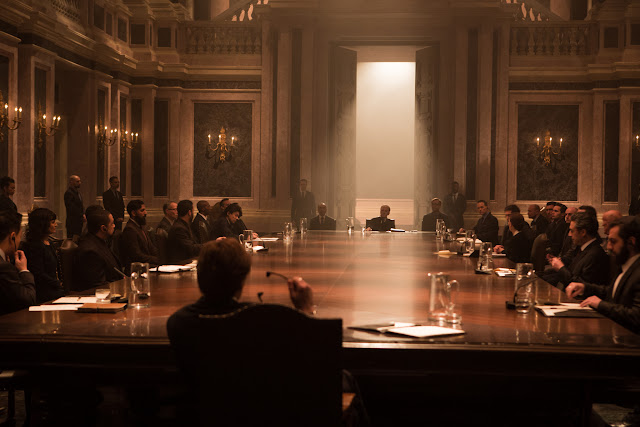 Oberhauser (Christoph Waltz) chairs a meeting in Metro-Goldwyn-Mayer Pictures/Columbia Pictures/EON Productions' action adventure SPECTRE.