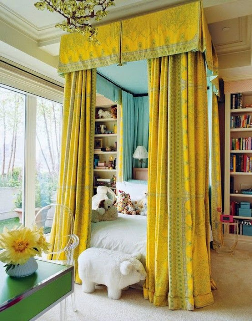 bold citron and turquoise master bedroom canopy bed