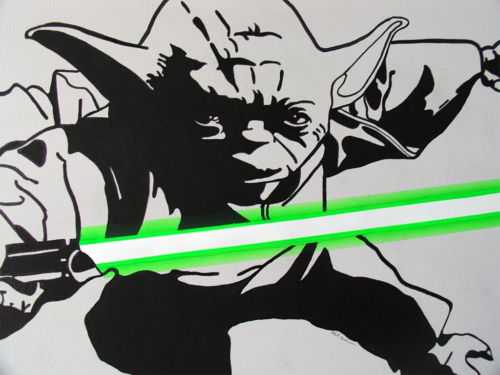 A close up of a wall painting of Yoda