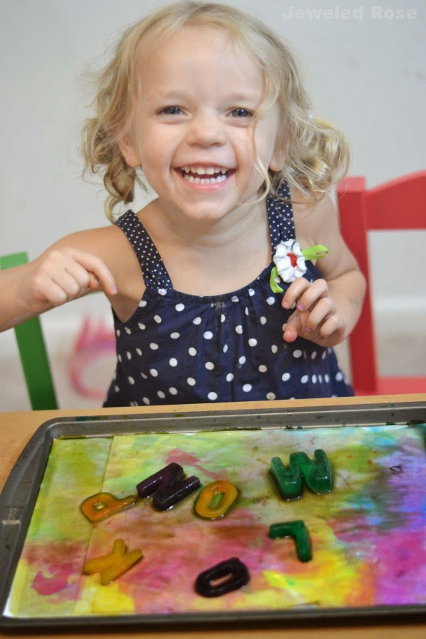 Painting with alphabet ice paints- a super fun Summer activity and the paints are easy to make, too!