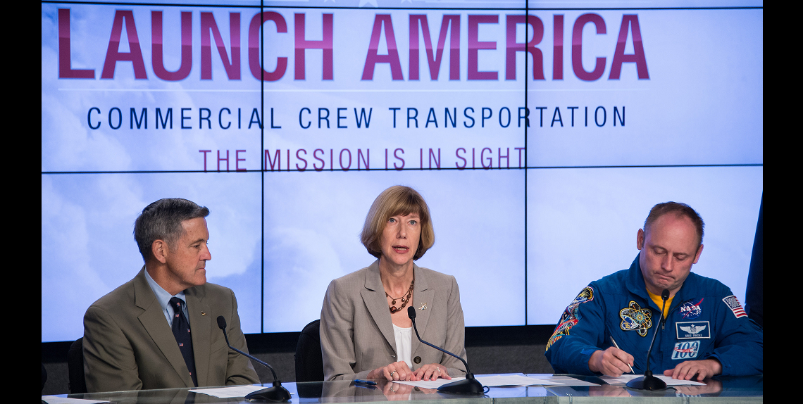 Kathy Lueders, program manager of NASA's Commercial Crew Program, speaks, as Former astronaut Bob Cabana, director of NASA's Kennedy Space Center in Florida, left, and Astronaut Mike Fincke, a former commander of the International Space Station look on during a news conference where it was announced that Boeing and SpaceX have been selected to transport U.S. crews to and from the International Space Station using the Boeing CST-100 and the SpaceX Crew Dragon spacecraft, at NASA's Kennedy Space Center in Cape Canaveral, Fla. on Tuesday, Sept. 16, 2014. Credit: NASA/Bill Ingalls
