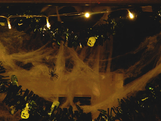 Fake cobwebs, tinsel, and lights.