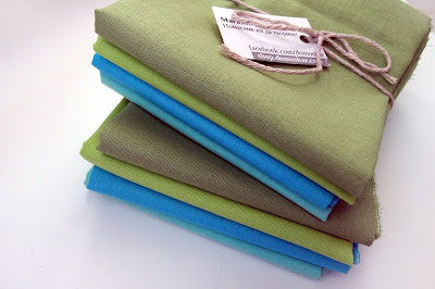 fat quarter bundles of fabric in blue and green