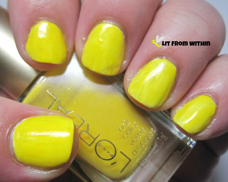 L'Oreal Tweet Me, a yellow jelly with orange shimmer (over white)