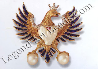 Verdura's heraldic eagle brooch of sapphires, diamonds, rubies, baroque and cultured pearls, 1956.