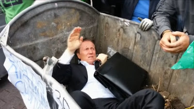 Politician thrown into garbage bin by angry Ukrainian mob