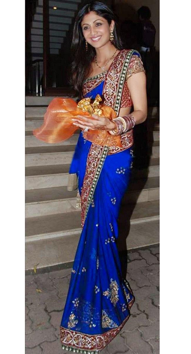 Yoga Teacher Shilpa Shetty in a Dark Blue Classic Saree with Red Golden Border