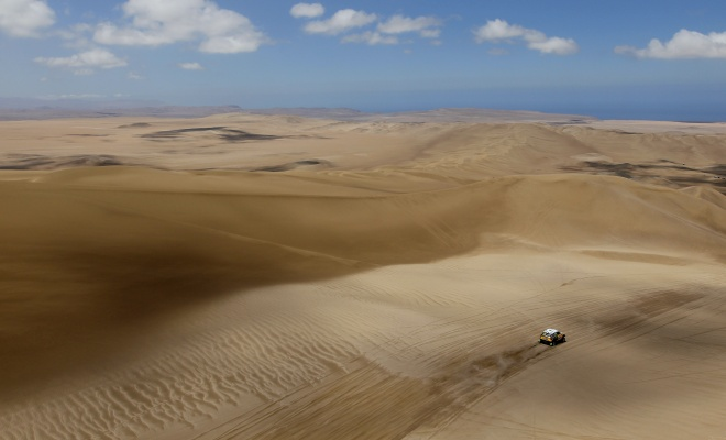 Small rally car in a big desert