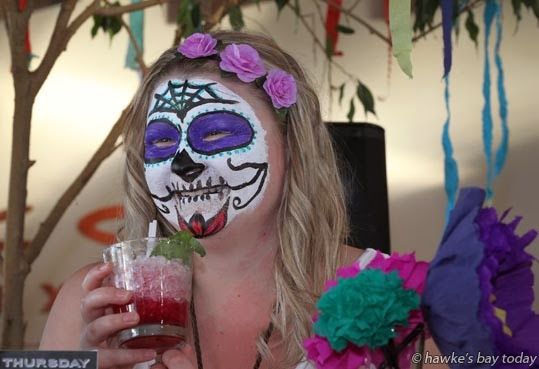"Kristen Clothier, Hastings, made up as a ""sugar-skull"" celebrating the Day of the Dead Festival, at a Mexican Fiesta dress-up at The Corn Exchange, Hastings photograph"