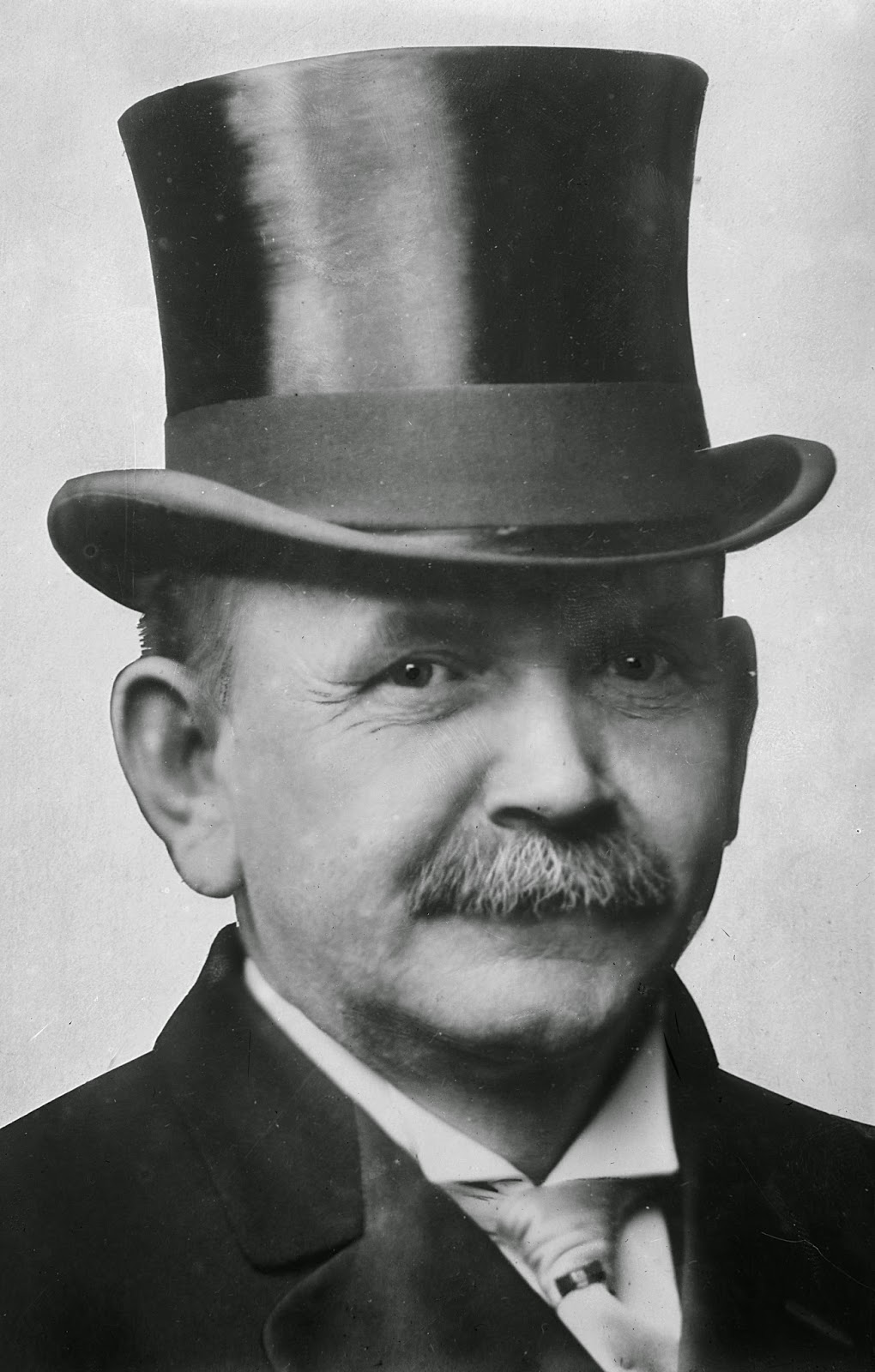 man with top hat and moustache