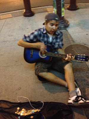 str8t park panhandler plays guitar for cash