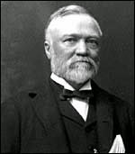 Black and white photo of Carnegie, wearing suit, has white beard.