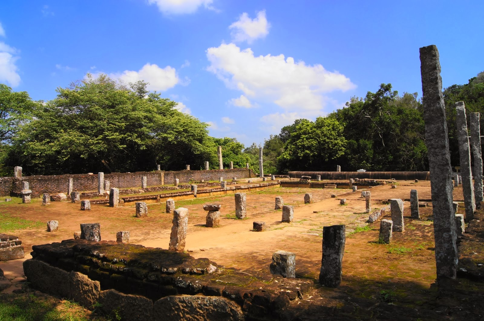 ruins of monastery's refectory Mihintale, columns of sandstone, brick walls, stone trough