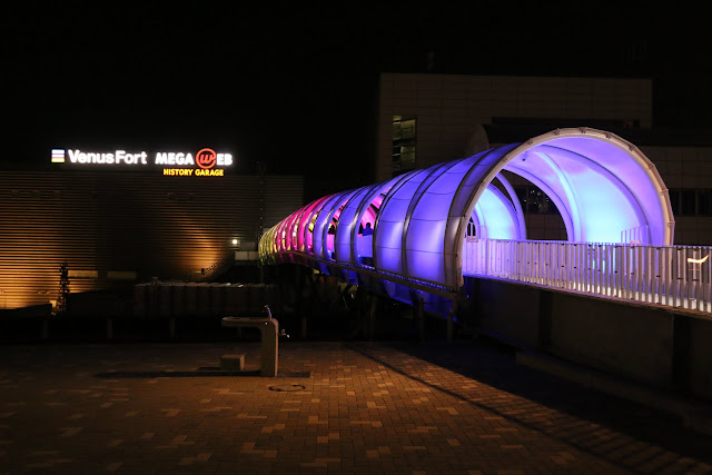 Colourful illuminated lights keep changing along the walkways at Odaiba Tokyo Bay in Japan