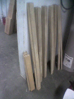 leaning against a wall of my workshop are 18 boards reclaimed from a broken futon frame. The nearest 6 boards were used to build a functional rough design.