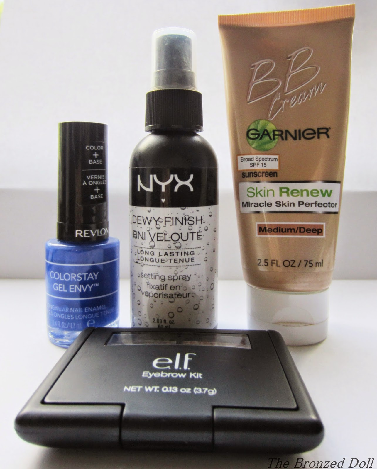 August Monthly favorites featuring nyx dewy setting spray, garnier bb cream, e.l.f eyebrow kit and revlon gel envy nail polish products