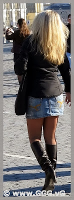Girl in high heels boots on the street