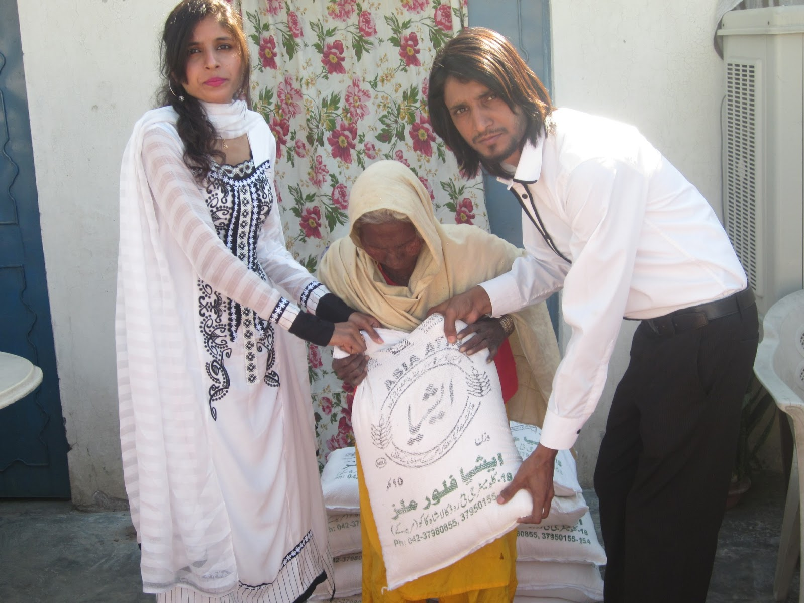 Me and my Wife Give Flour to Christian Widow